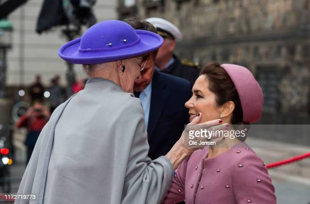 Crown Princess Mary curtseys to Queen Margrethe of Denmark as they attend the opening of Parliament on October 1, 2019 in Copenhagen, Denmark. In...