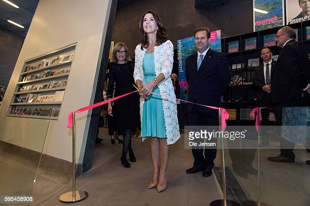 Crown Princess Mary cuts the tape for the opening of the French painter Monet exhibition at Ordrupgaard Museum in Charlottenlund in Denmark on August...