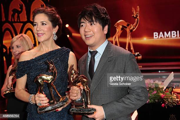 Crown Princess Mary Elisabeth of Denmark and Pianist Lang Lang pose with their awards during the Bambi Awards 2014 show on November 13 2014 in Berlin...