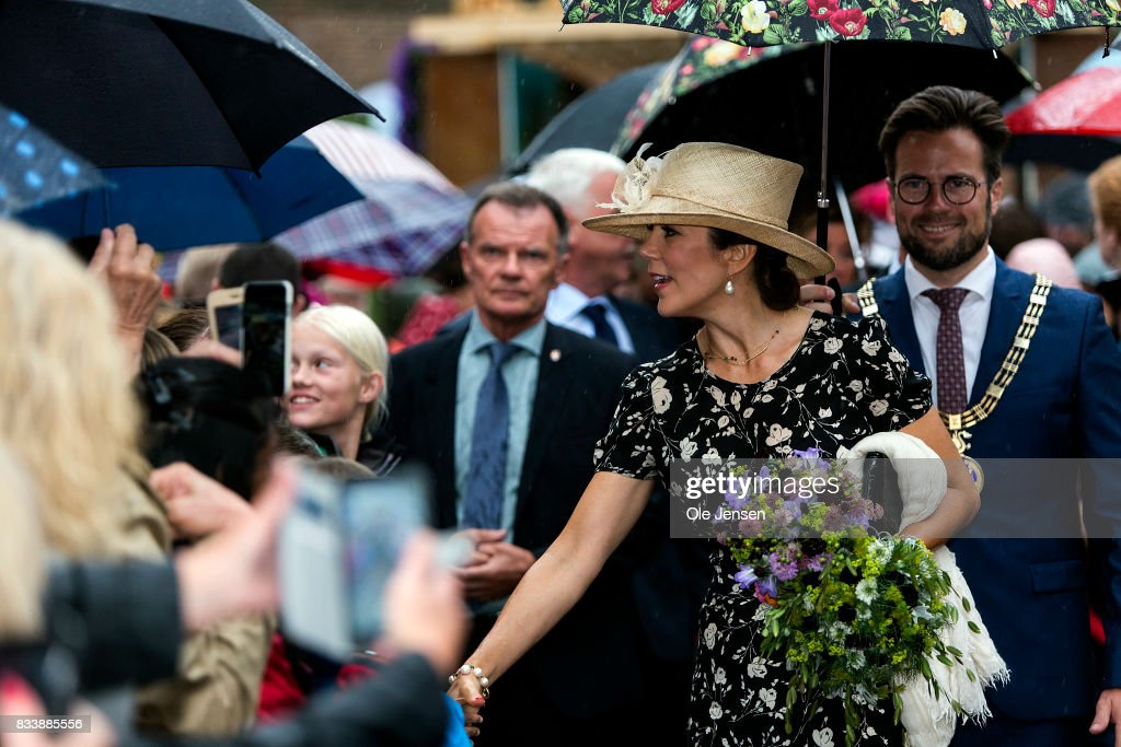 Crown Princess Mary greet spectators at Odense Flower Festival which she is to open officially and where she is to be presented to a new developed rose on August 17, 2017 in Odense, Denmark. The festival opens today and ends August 20 and takes place all over the inner city with some 100.000 plants made up with the theme 'What a Woinderful World' and urban gardening.