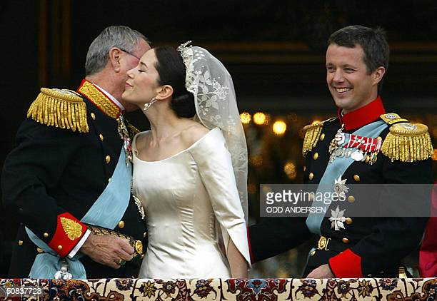 Crown princess Mary kisses her father in law Prince Henrik watched by husband Crown prince Frederik of Denmark at the balcony of Amalienborg castle...