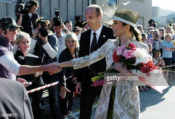 Crown Princess Mary of Denmark accompanied by her husband Crown Prince Frederik waves to wellwishers after a visit to the Tasmanian University Centre...
