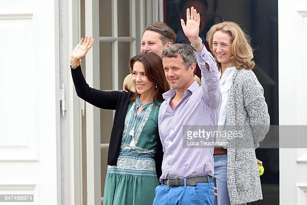 Crown Princess Mary of Denmark and Crown Prince Frederik of Denmark wave to the photographers at the annual summer photo call for The Danish Royal...
