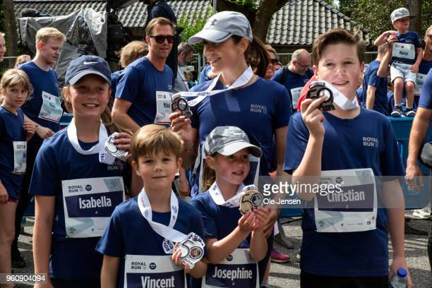 Crown Princess Mary of Denmark and her children Princess Isabella, Prince Vincent, Prince Christian and Princess Josephine - proudly show their...