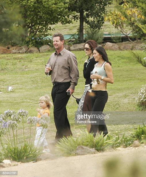 Crown Princess Mary of Denmark and her sister Patricia Bailey walk with relative Brendan Johncock at the wedding of her cousin Alison Donaldson on...