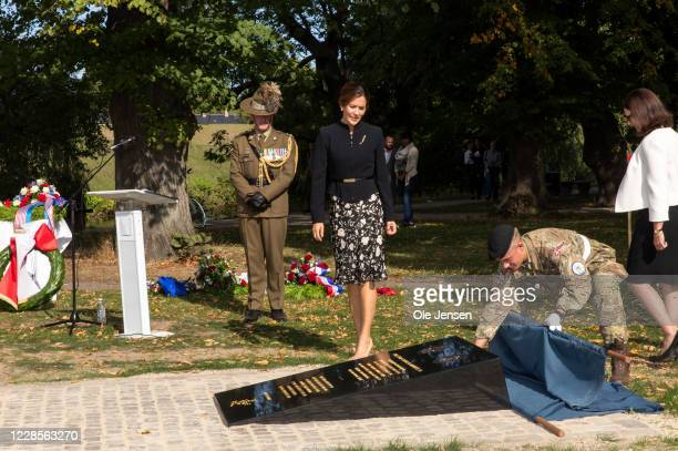 Crown Princess Mary of Denmark and Mary Ellen Miller, Australian Ambassador to Denmark, during their joint wreath laying at the official inauguration...