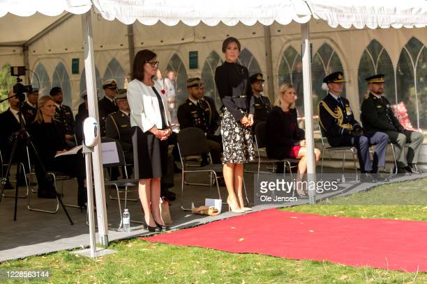 Crown Princess Mary of Denmark and MaryEllen Miller Australian Ambassador to Denmark standing during the wreath laying ceremony at the official...