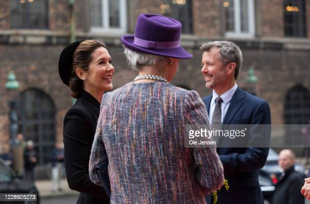 Crown Princess Mary of Denmark and Prince Frederik talk to Princess Benedikte as they arrive at Christiansborg Palace on October 6, 2020 in...