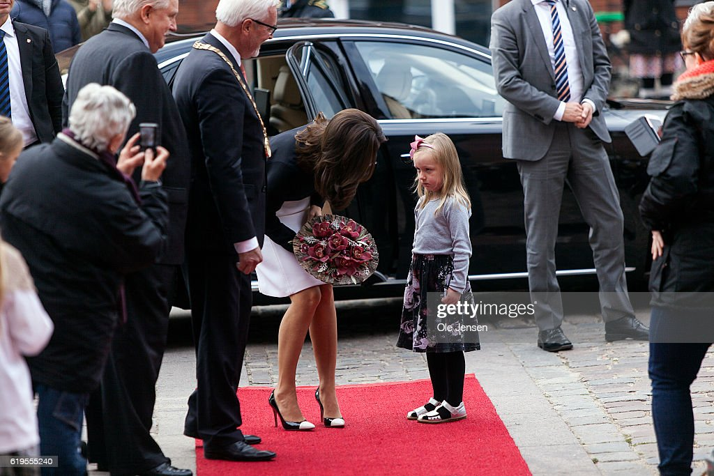 Crown Princess Mary of Denmark arrives to the prestigious Hans Christian Andersen Literature Award presentation to Japanese author Haruki Murakami and receives a bouquet of flowers from a young girl at Odense City Hall in Denmark on October 30, 2016. Hans Christian Andersen (1805 - 1875) wrote among other story's The Ugly Duckling.
