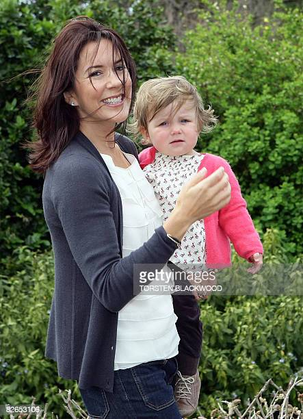 Crown Princess Mary of Denmark carries her daughter Princess Isabella age one through the gardens of Government House in Sydney on September 4 2008...