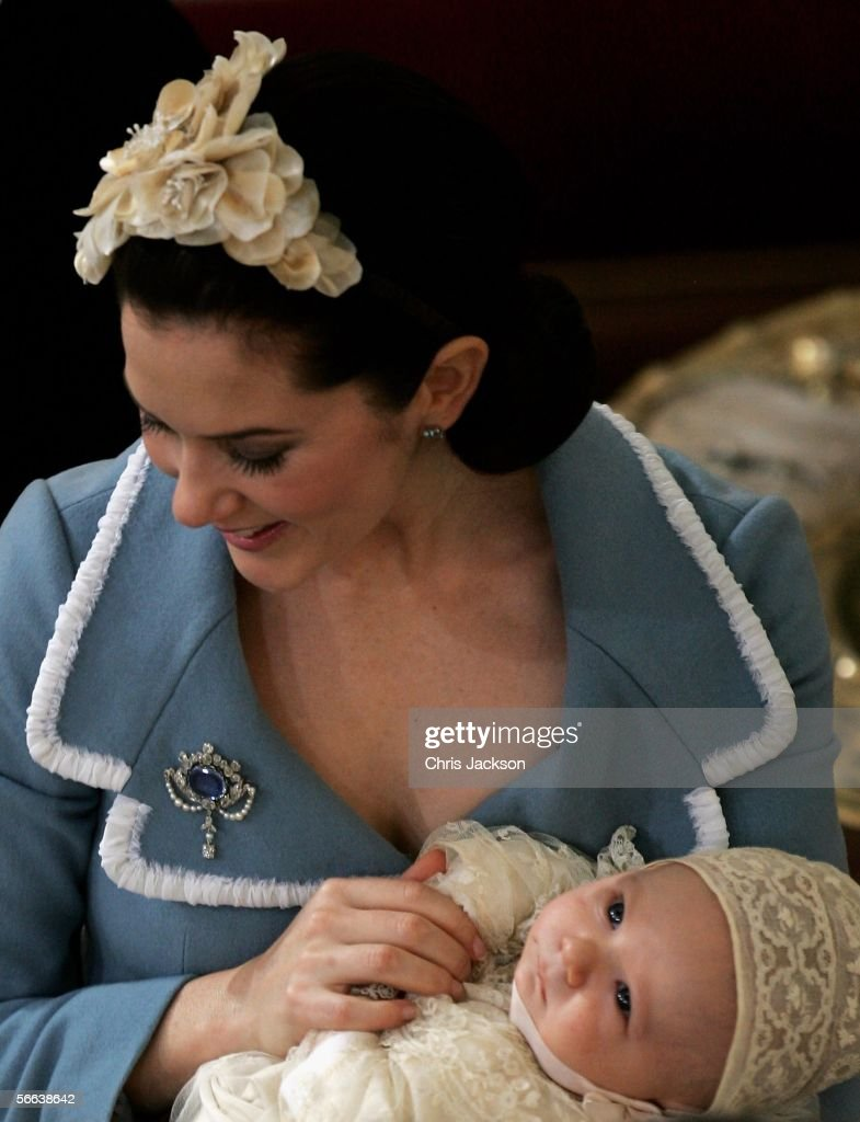 Crown Princess Mary of Denmark cradles her son and heir to the Danish throne Crown Prince Christian of Denmark as they depart from the Royal Christening ceremony at Christiansborg Palace Church on January 21, 2006 in Copenhagen, Denmark. The new Prince was born on October 14, 2005 at Copenhagen University Hospital and is the first child for the Royal couple.