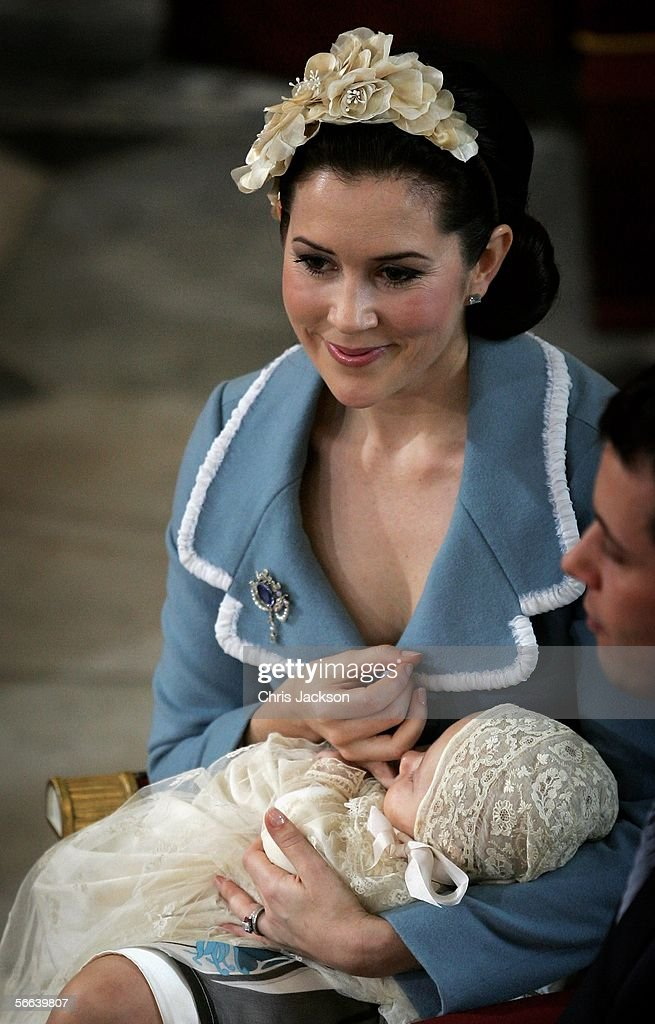 Crown Princess Mary of Denmark cradles her son and heir to the Danish throne Crown Prince Christian of Denmark as her husband Crown Prince Frederik of Denmark looks on during the Royal Christening ceremony at Christiansborg Palace Church on January 21, 2006 in Copenhagen, Denmark. The new Prince was born on October 14, 2005 at Copenhagen University Hospital and is the first child for the Royal couple.