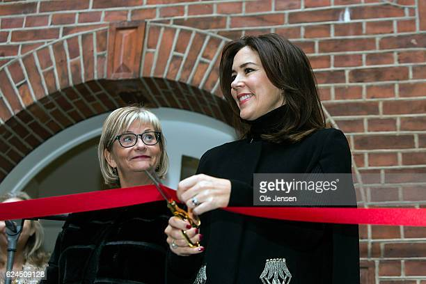 Crown Princess Mary of Denmark cuts the red ribbon at the opening ceremony for the Danish Mother's Aid's new family councel house on November 18 2016...