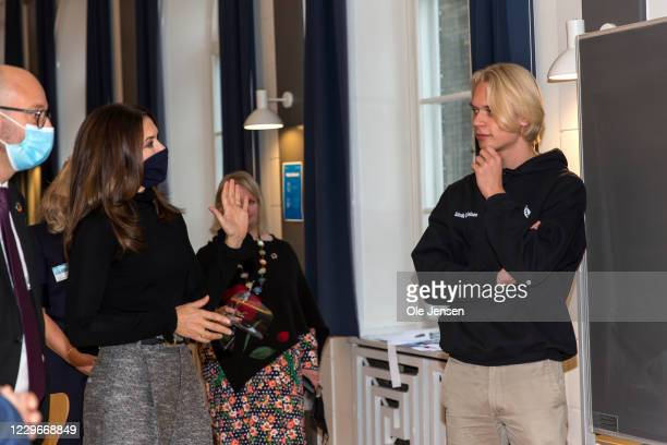 Crown Princess Mary of Denmark discuss a project with student during her visit to Roskilde Gymnasium on November 18, 2020 in Roskilde, Denmark. The...