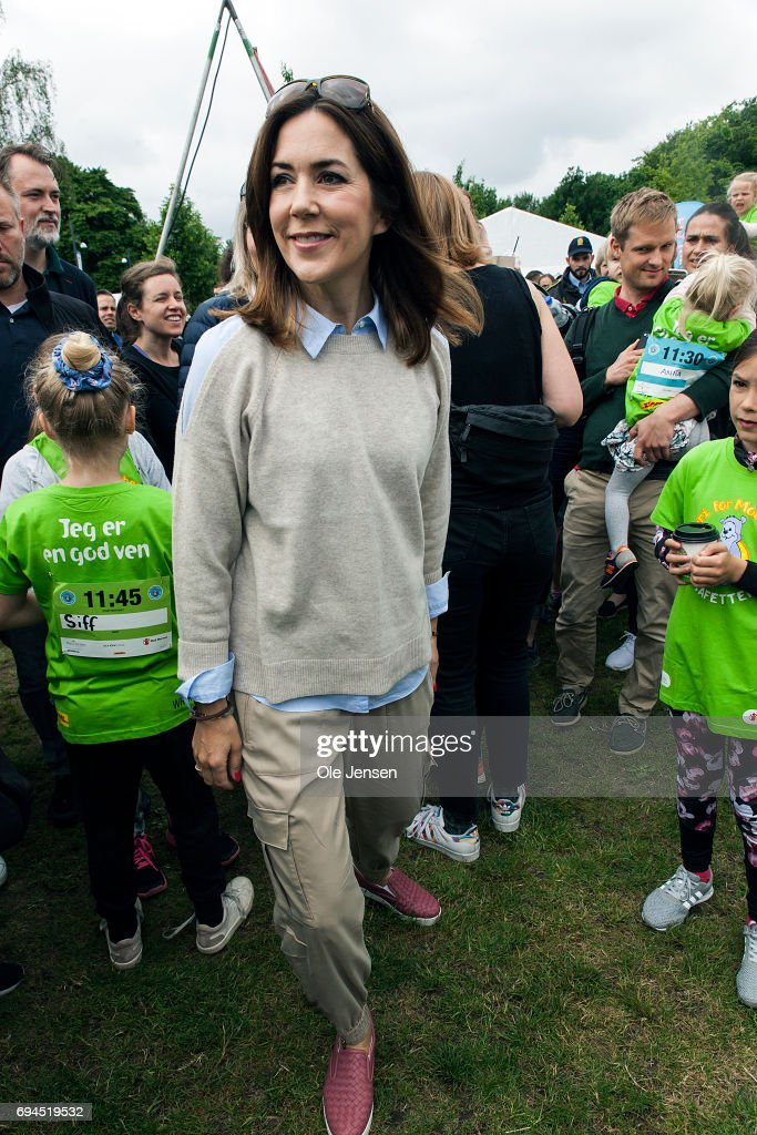 Crown Princess Mary of Denmark during the 'Children's Relay Run' in Faelledparken on June 10, 2017 in Copenhagen, Denmark. The kids (age 0 - 8 years) relay run is part of the Crown Princess' organization 'The Mary Foundation's fight against bullying among children through building up safe community and interaction among them. The organisation ''Save the Children Denmark' (Red Barnet) was co-organizer of the event and the toy manufacturer LEGO, co-founder of the Mary Foundation, took also part in the event.
