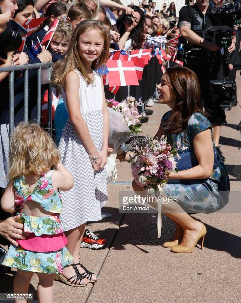 Crown Princess Mary of Denmark greets school children on the Opera House forecourt on October 24 2013 in Sydney Australia Prince Frederick and...