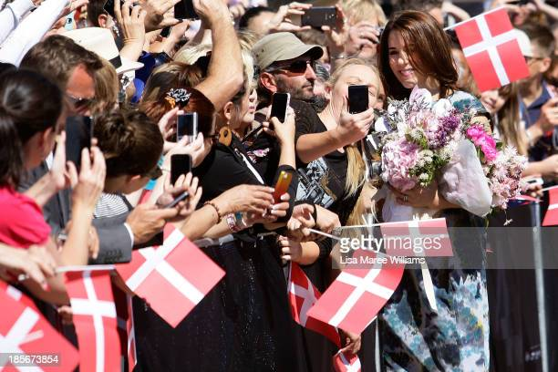 Crown Princess Mary of Denmark has her photograph taken with fans on the Opera House forecourt on October 24 2013 in Sydney Australia Prince Frederik...
