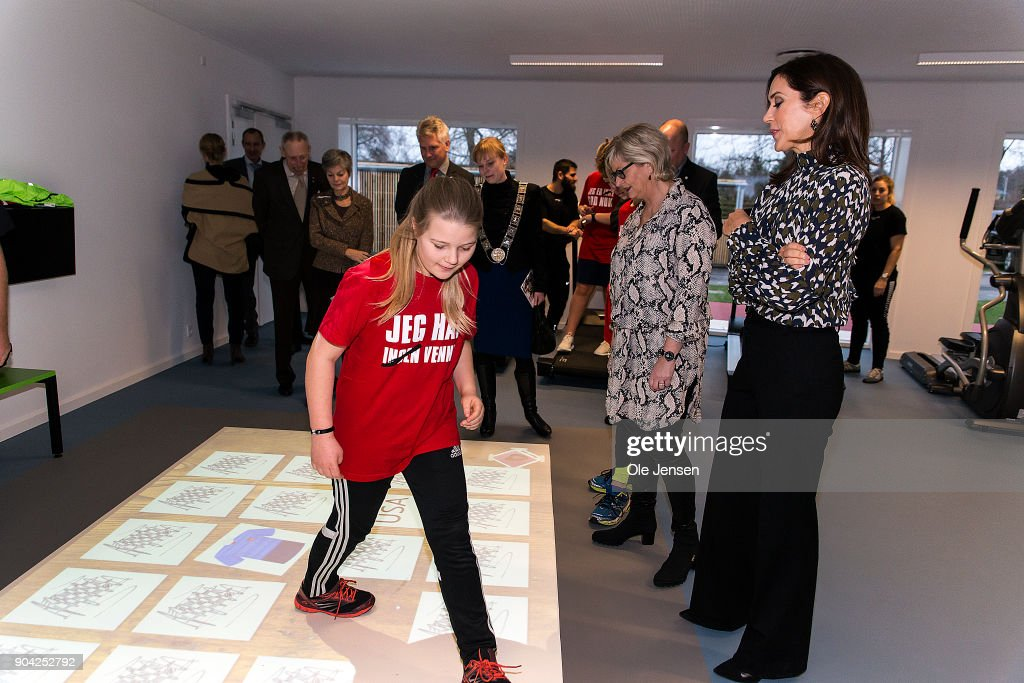Crown Princess Mary of Denmark (R) in the exercise room, where she watch a girl exercising on an 'Active Floor' during her visit to the Christmas Seal Foundation home opening on January 12, 2018 in Roskilde, Denmark. The Crown Princess is the patron of the Christmas Seal Foundation where labels are placed on mail during the festive period to help raise money for underprivileged children, through the sale of the annual Christmas Seal. Children suffering from psychological issues are then able to stay in one of the six homes in Denmark, for a period of up to 10 weeks to help them rehabilitate.