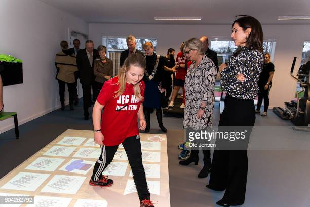 Crown Princess Mary of Denmark in the exercise room where she watch a girl exercising on an 'Active Floor' during her visit to the Christmas Seal...