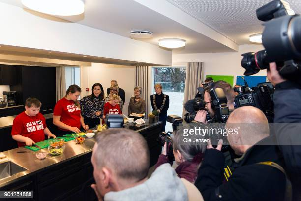 Crown Princess Mary of Denmark in the kitchen together with kids preparing food during the Princess visit at The Christmas Seal Foundation's home...
