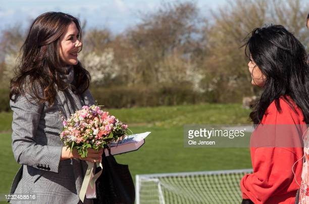 Crown Princess Mary Of Denmark is given a bouquet of flowers during her arrival to UNFPA's State Of World Population Report Release at Gerlev Sports...