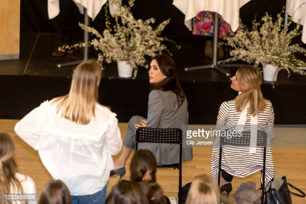 Crown Princess Mary Of Denmark is looking at a student who ask a question regarding UNFPA's State Of World Population Report Release at Gerlev Sports...
