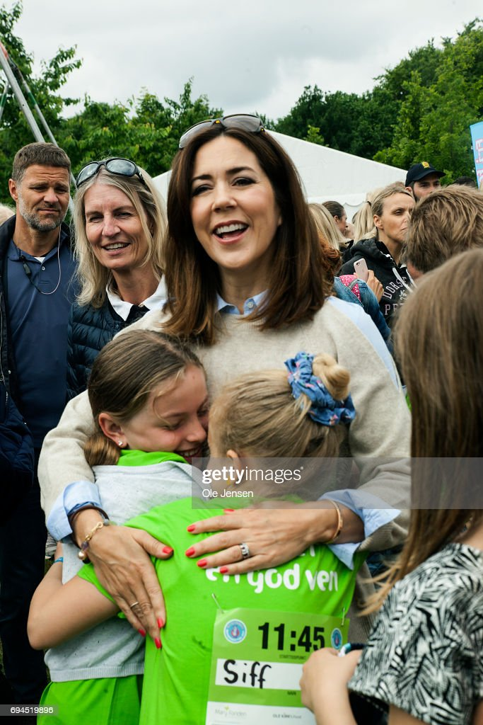 Crown Princess Mary of Denmark is warmly welcomed by kids during the 'Children's Relay Run' in Faelledparken on June 10, 2017 in Copenhagen, Denmark. The kids (age 0 - 8 years) relay run is part of the Crown Princess' organization 'The Mary Foundation's fight against bullying among children through building up safe community and interaction among them. The organisation ''Save the Children Denmark' (Red Barnet) was co-organizer of the event and the toy manufacturer LEGO, co-founder of the Mary Foundation, took also part in the event.