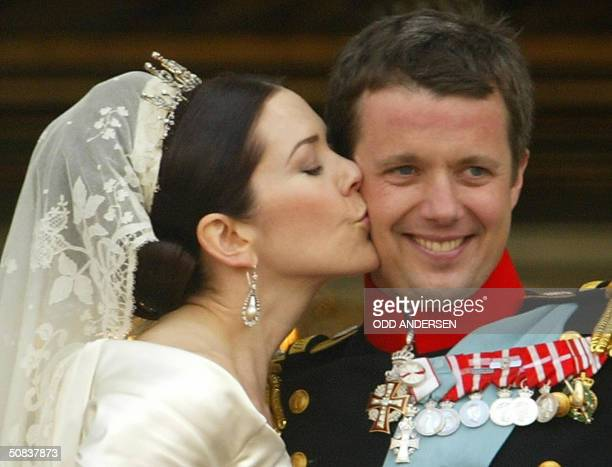 Crown princess Mary of Denmark kisses her husband Crown prince Frederik in front of thousands of wellwishers standing on the balcony of Amalienborg...