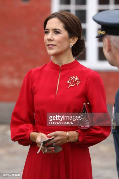 Crown Princess Mary of Denmark looks on before a wreathlaying ceremony at the monument for fallen soldiers at the Citadel in Copenhagen Denmark on...