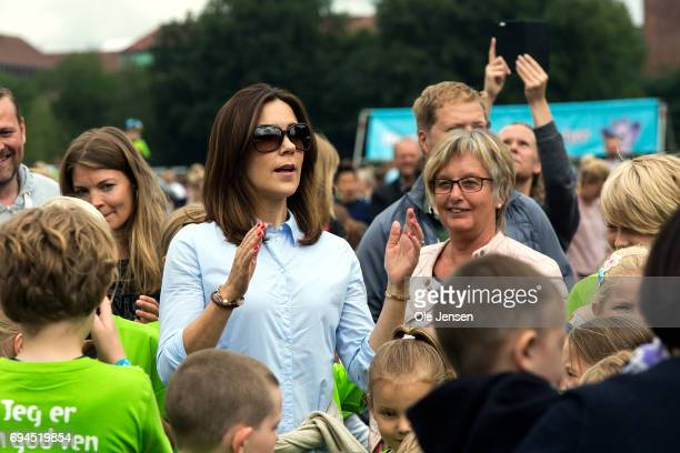 Crown Princess Mary of Denmark participates in the warmup exercise during the 'Children's Relay Run' in Faelledparken on June 10 2017 in Copenhagen...