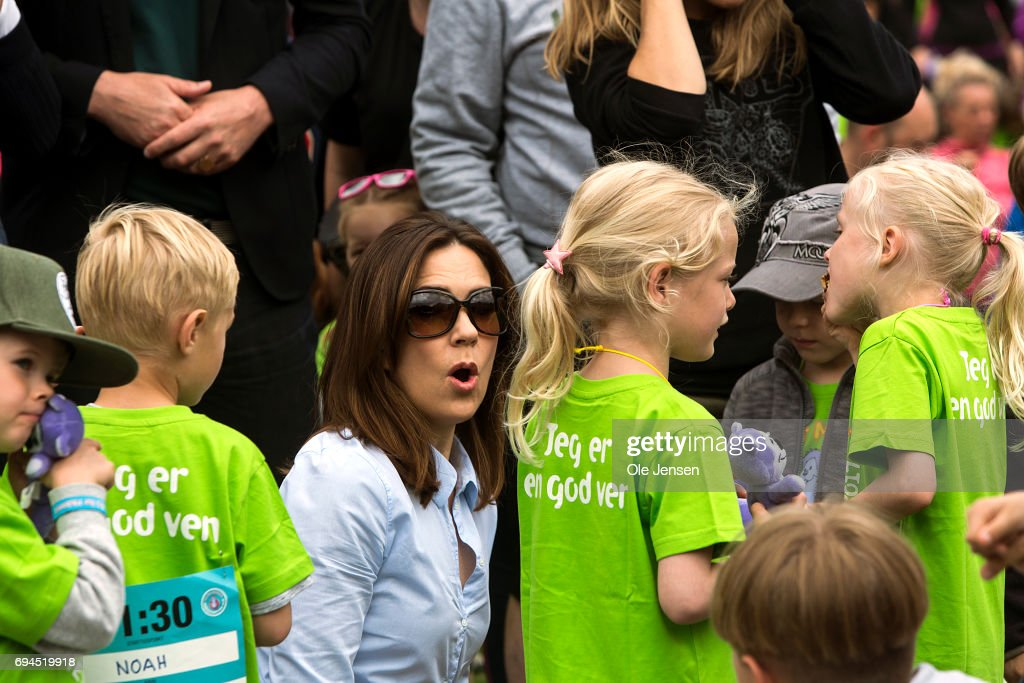 Crown Princess Mary of Denmark participates in the warm-up exercise during the 'Children's Relay Run' in Faelledparken on June 10, 2017 in Copenhagen, Denmark. The kids (age 0 - 8 years) relay run is part of the Crown Princess' organization 'The Mary Foundation's fight against bullying among children through building up safe community and interaction among them. The organisation ''Save the Children Denmark' (Red Barnet) was co-organizer of the event and the toy manufacturer LEGO, co-founder of the Mary Foundation, took also part in the event.