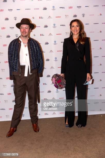 Crown Princess Mary of Denmark poses together with Niels Lautrup Holm, chair for the Danish Rainbow Awards at Cirkusbygningen on September 30, 2020...