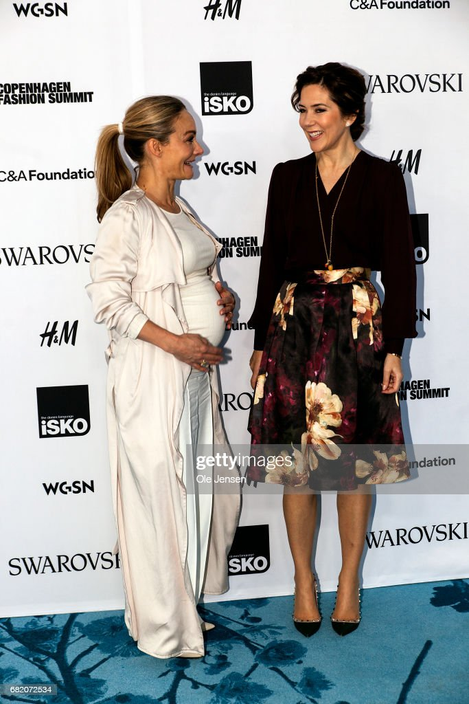 Crown Princess Mary of Denmark (R) poses with Eva Kruse President and CEO of Global Fashion Agenda during Copenhagen Fashion Summit on May 11, 2017 in Copenhagen, Denmark. The 2017 Summit addressed four specific paths to sustainability: the macro perspective, circular design, supply chain transparency and sustainable consumption. All four paths pertained to topics that are of particular opportunity, as uncovered in the 'Pulse of the Fashion Industry' report, jointly researched and produced by the Global Fashion Agenda and the Boston Consulting Group and presented at the Summit, which had some 1000 participants from the global fashion industry.