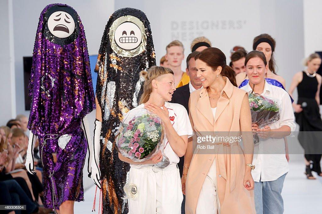 Crown Princess Mary of Denmark presents the Designers Nest Award to Sara Lundberg during the third day of Copenhagen Fashion Week Spring/Summer 2016 on August 7, 2015 in Copenhagen, Denmark.