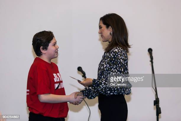 Crown Princess Mary of Denmark receives a special version of the Christmas Seal during the Princess visit at The Christmas Seal Foundation's home...