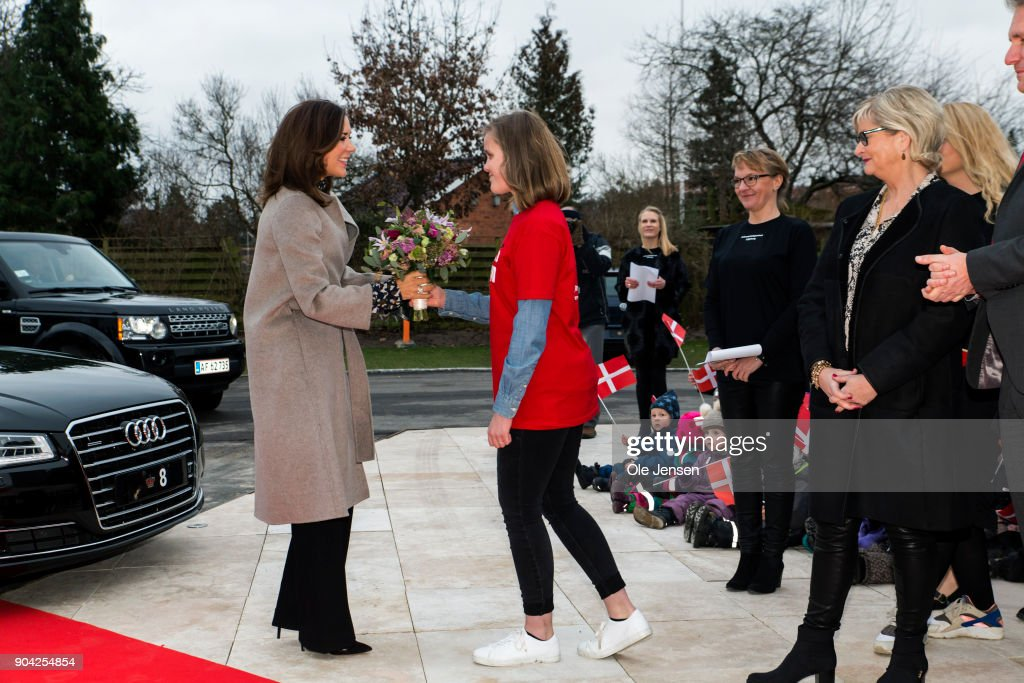 Crown Princess Mary of Denmark (L) receives flowers at her arrival to the Christmas Seal Foundation home opening on January 12, 2018 in Roskilde, Denmark. The Crown Princess is the patron of the Christmas Seal Foundation where labels are placed on mail during the festive period to help raise money for underprivileged children, through the sale of the annual Christmas Seal. Children suffering from psychological issues are then able to stay in one of the six homes in Denmark, for a period of up to 10 weeks to help them rehabilitate.