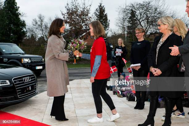 Crown Princess Mary of Denmark receives flowers at her arrival to the Christmas Seal Foundation home opening on January 12 2018 in Roskilde Denmark...