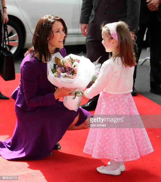 Crown Princess Mary of Denmark receives flowers from Isabelle Ricco before she unveils a statue of the late Dr Victor Chang outside of the Lowy...