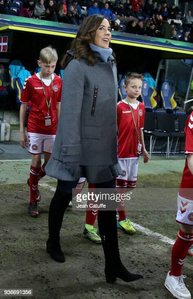 Crown Princess Mary of Denmark receives from Danish Football Association DBU President Jesper Moller a check of 50 000 euros from 'UEFA Foundation...