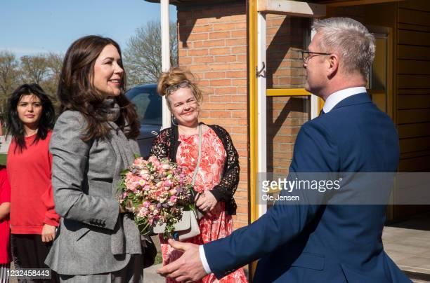 Crown Princess Mary Of Denmark seen speaking Flemming Møller Mortensen, Minister for Development Cooperation and Nordic Cooperation, during arrival...