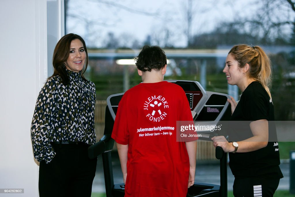 Crown Princess Mary of Denmark (L) speaks to a young boy doing physical exercise during the Christmas Seal Foundation home opening on January 12, 2018 in Roskilde, Denmark. The Crown Princess is the patron of the Christmas Seal Foundation where labels are placed on mail during the festive period to help raise money for underprivileged children, through the sale of the annual Christmas Seal. Children suffering from psychological issues are then able to stay in one of the six homes in Denmark, for a period of up to 10 weeks to help them rehabilitate.