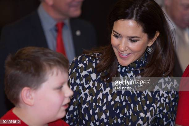 Crown Princess Mary of Denmark speaks to a young boy during her visits to the Christmas Seal Foundation home opening on January 12 2018 in Roskilde...