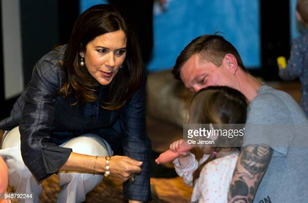 Crown Princess Mary of Denmark speaks to children and parents during the opening of science center for todlers at Copenhagen Experimentarium on April...