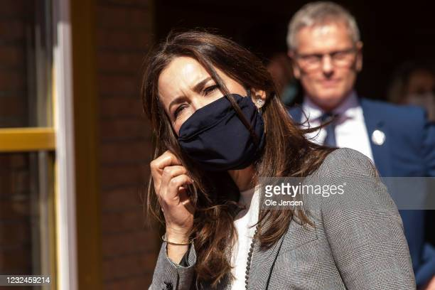 Crown Princess Mary Of Denmark takes off her face mask as he leaves UNFPA's State Of World Population Report Release at Gerlev Sports High School on...