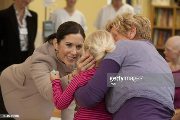 Crown Princess Mary of Denmark talks to childs during her visit at the cancer uniclinic for kids and teenager on September 28 2010 in Rostock Germany...