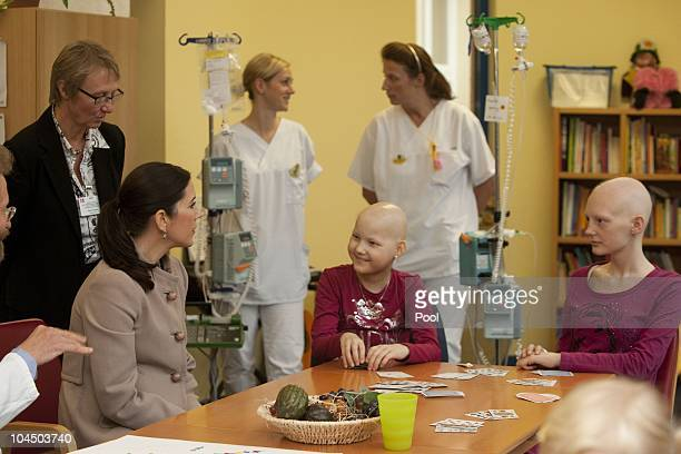 Crown Princess Mary of Denmark talks to Corinna Diederich and Jenny Lentz during her visit at the cancer uniclinic for kids and teenager on September...