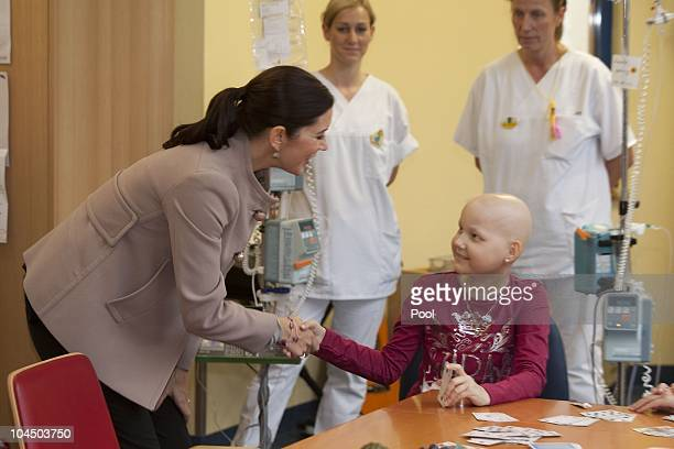 Crown Princess Mary of Denmark talks to Corinna Diederich during her visit at the cancer uniclinic for kids and teenager on September 28 2010 in...