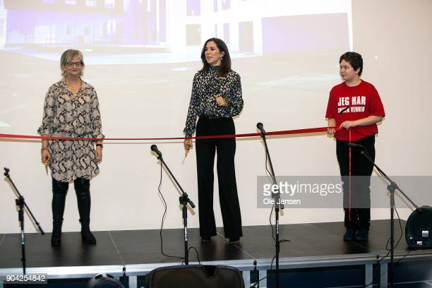 Crown Princess Mary of Denmark together with Managing Directpr Winnie Liljeborg of the Christmas Seal Foundation are ready to cut the red band for...