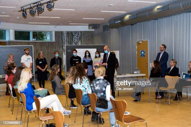 Crown Princess Mary of Denmark together with Minister of Development, Rasmus Prehn, seen at their visit to Roskilde Gymnasium on November 18, 2020 in...