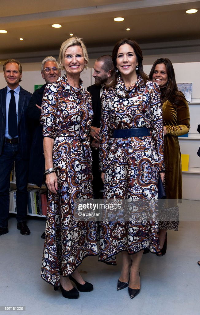 Crown Princess Mary of Denmark (R) together with Nina Wedell-Wedellsborg, board member at the Magasin du Nord Foundation, at the Magasin du Nord Fashion Prize 2017 ward ceremony at Charlottenborg on October 27, 2017 in Copenhagen, Denmark. The Crown Princess is joking about they both attends the ceremony wearing gowns of identical design, Danish Britt Sisseck. Wedellsborg said later that this was absolutely coincidental.